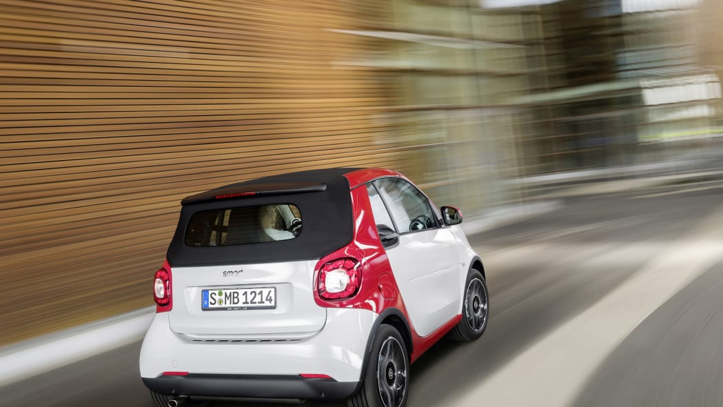 The 2016 Smart Fortwo Cabriolet, passion trim, rear three-quarter top up.
