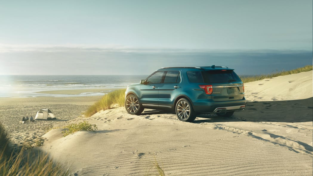 Ford shows off 2016 Explorer in Platinum trim, with Sony premium audio, front three-quarter on the sand.