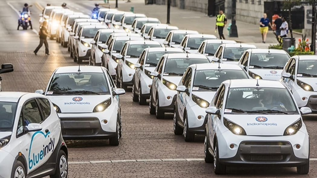 About 30 BlueIndy Carsharing EVs lined up