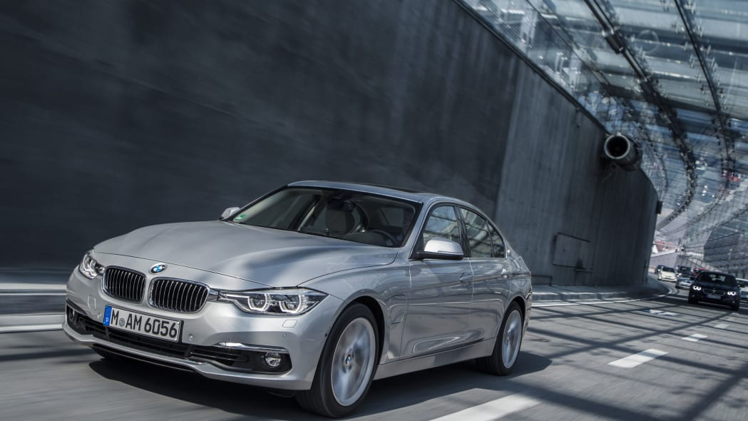 bmw 330e on road front