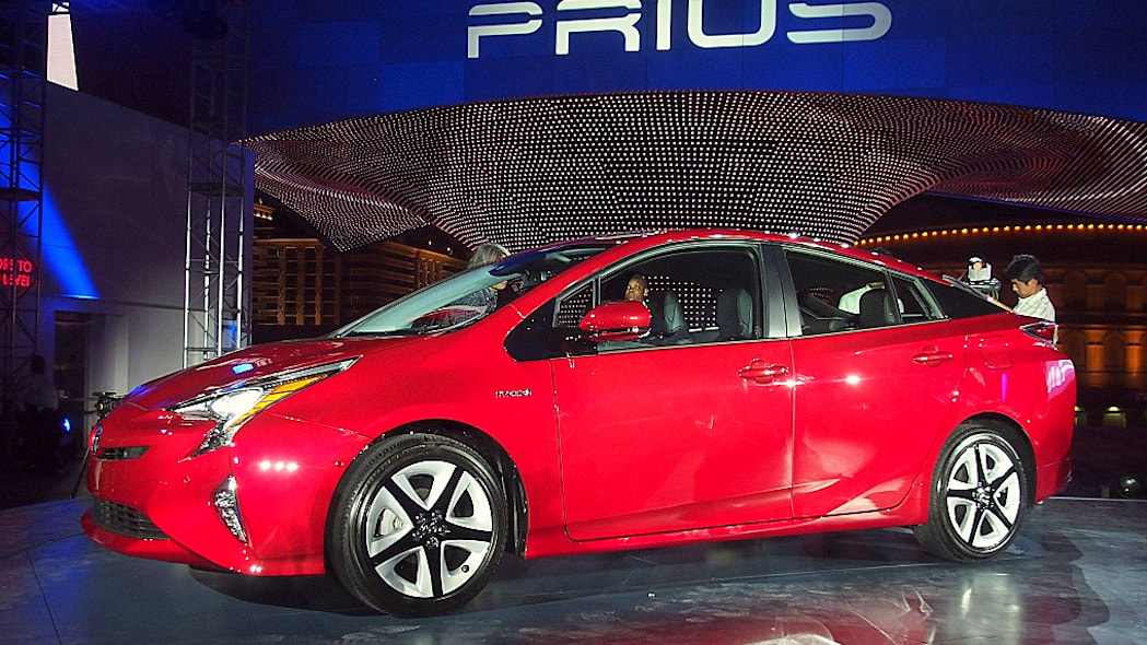 2016 Toyota Prius red, at reveal event, front side profilt