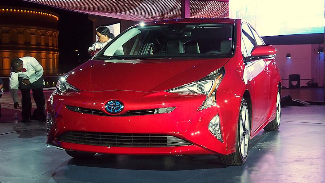 2016 Toyota Prius red, at reveal event, front 3/4