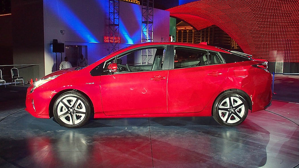 2016 Toyota Prius red, at reveal event, side profile