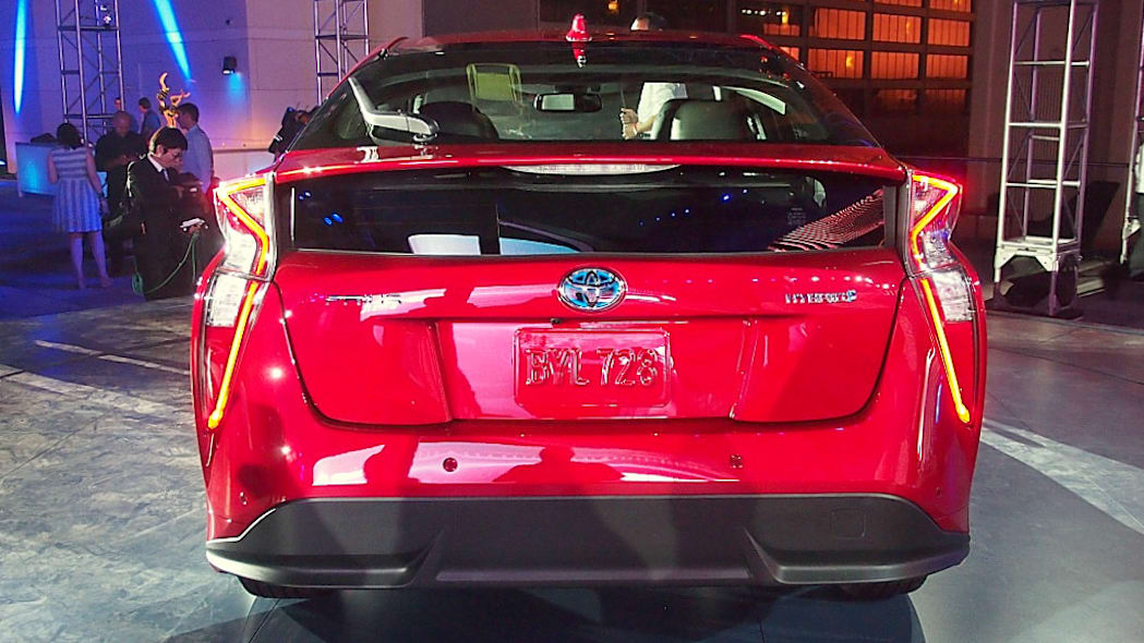 2016 Toyota Prius red, at reveal event, rear view