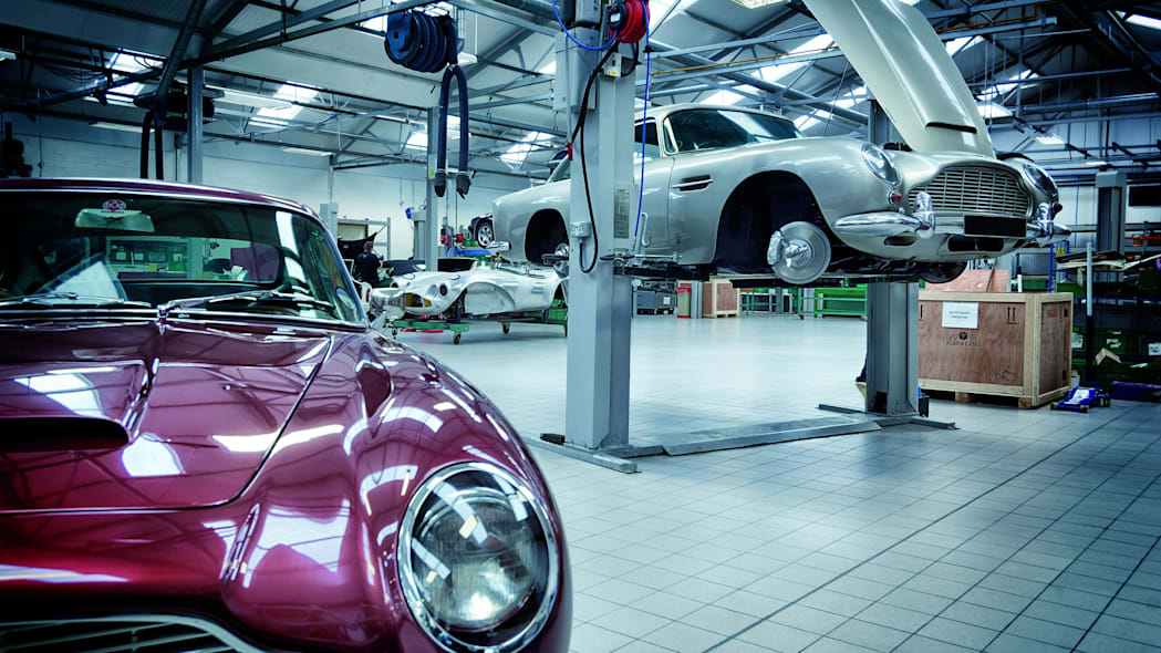 An Aston Martin DB5 on a lift inside Aston Martin Works at Newport Pagnell.