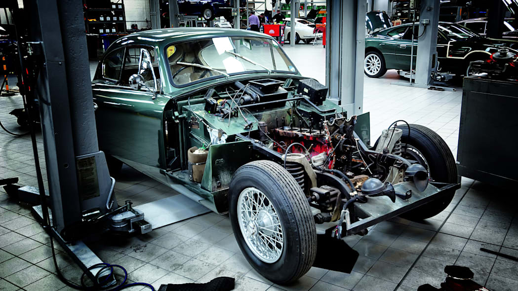 An Aston Martin is taken apart for mechanical inspection at Aston Martin Works at Newport Pagnell.