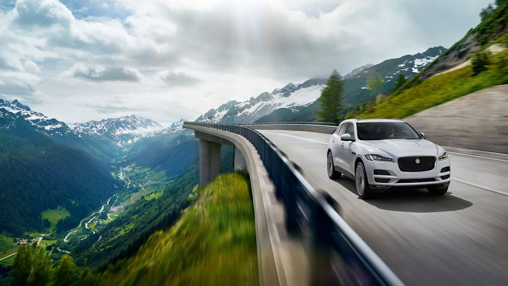 jaguar f-pace mountain bridge white action speed