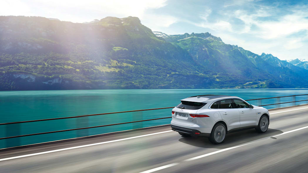 cuv rear action jaguar f-pace lake mountain