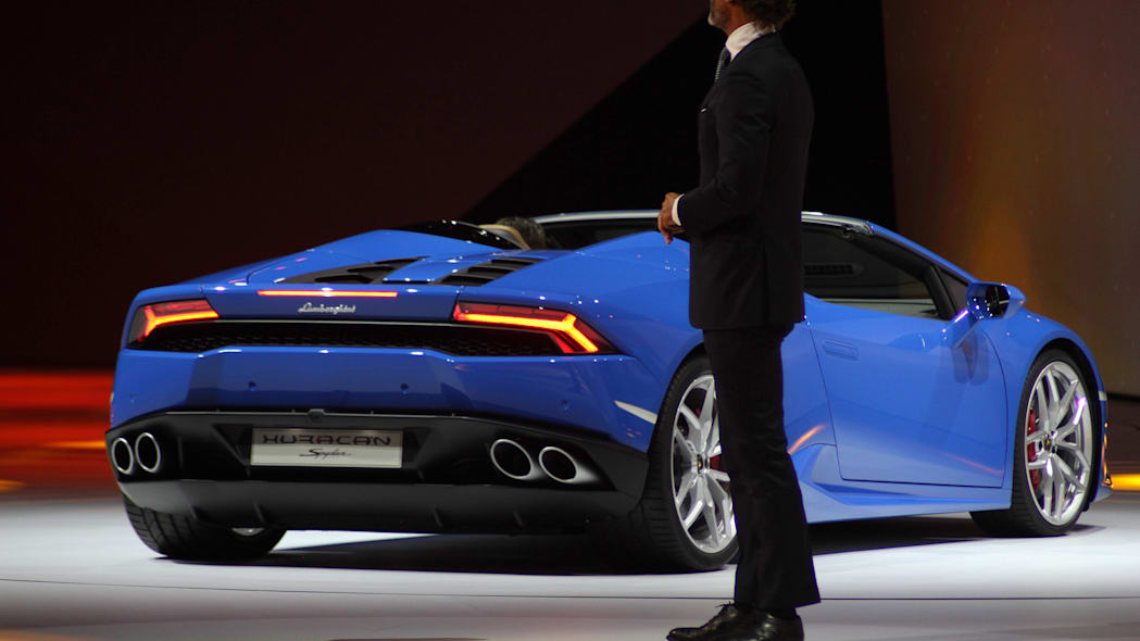 The 2016 Lamborghini Huracan Spyder is unveiled to the press by CEO Stephan Winklemann at Volkswagen Group Night ahead of the 2015 Frankfurt Motor Show, rear three-quarter view.