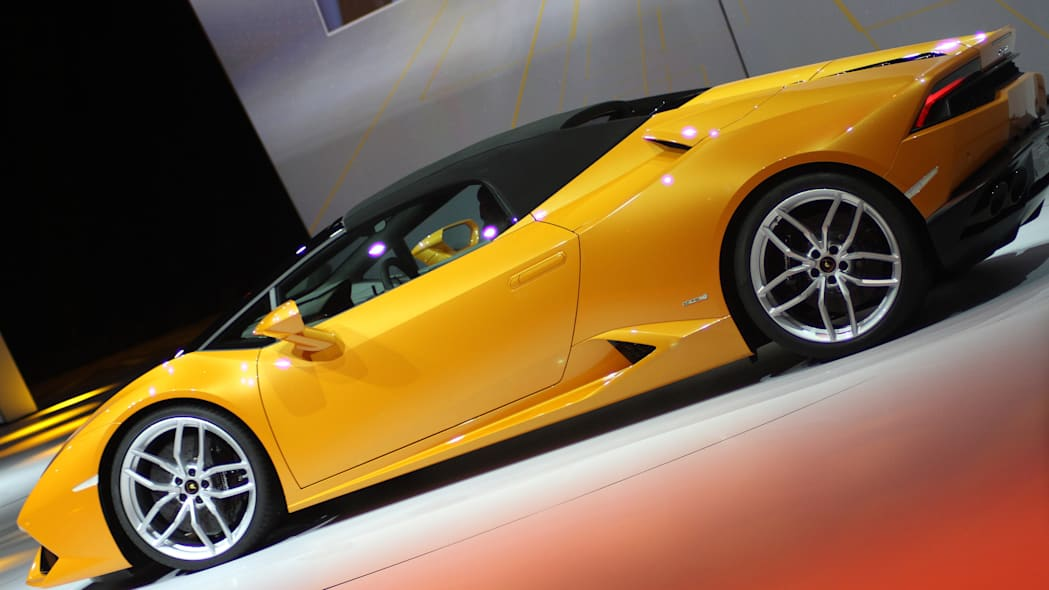 The 2016 Lamborghini Huracan Spyder is unveiled to the press at Volkswagen Group Night ahead of the 2015 Frankfurt Motor Show, rear three-quarter view with the top up.