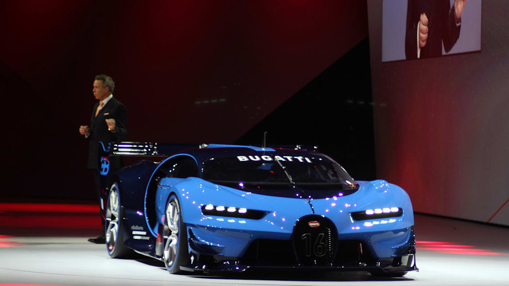 The Bugatti Vision Gran Turimso, designed for the Sony Playstation game Gran Turismo, is shown off at Volkswagen Group Night ahead of the 2015 Frankfurt Motor Show, front three-quarter view with brand CEO Wolfgang Durheimer.