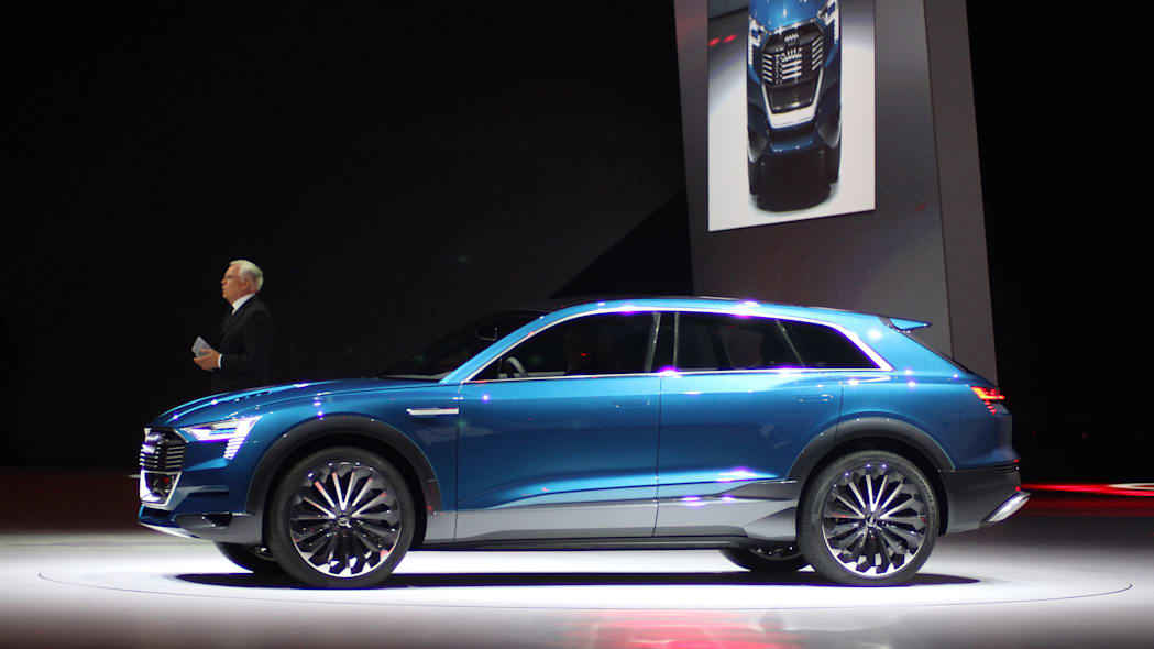 The Audi E-Tron Quattro concept is revealed to the press at Volkswagen Group Night ahead of the 2015 Frankfurt Motor Show, side view with Ulrich Hackenberg.