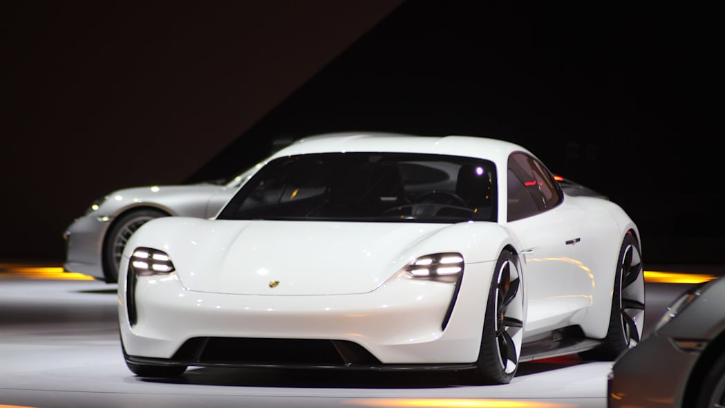 The electric Porsche Mission E concept, showed off at the Volkswagen Group Night ahead of the 2015 Frankfurt Motor Show, near front three-quarter view.