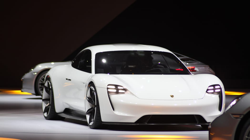 The electric Porsche Mission E concept, showed off at the Volkswagen Group Night ahead of the 2015 Frankfurt Motor Show, front three-quarter view.