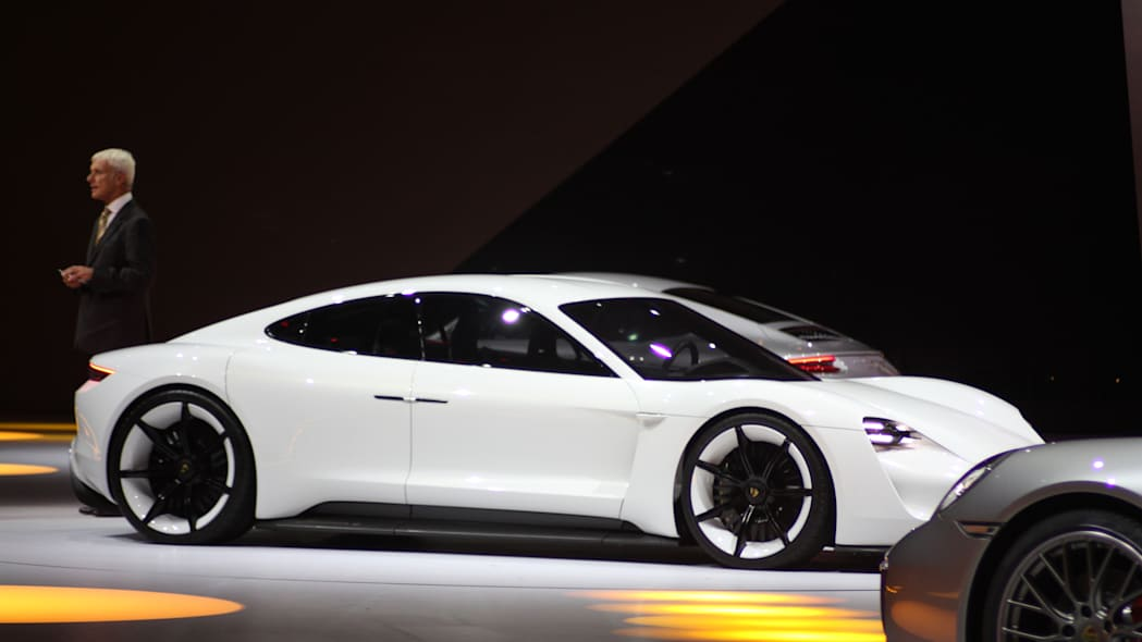 The electric Porsche Mission E concept, showed off at the Volkswagen Group Night ahead of the 2015 Frankfurt Motor Show, front three quarter.
