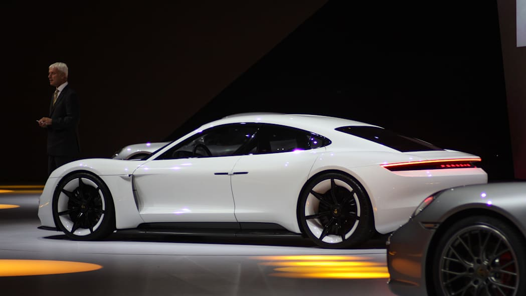 The electric Porsche Mission E concept, showed off at the Volkswagen Group Night ahead of the 2015 Frankfurt Motor Show, rear three-quarter.