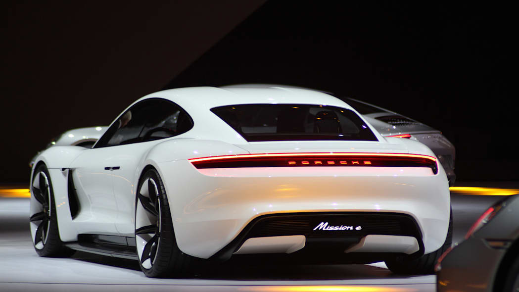 The electric Porsche Mission E concept, showed off at the Volkswagen Group Night ahead of the 2015 Frankfurt Motor Show, rear three-quarter view.