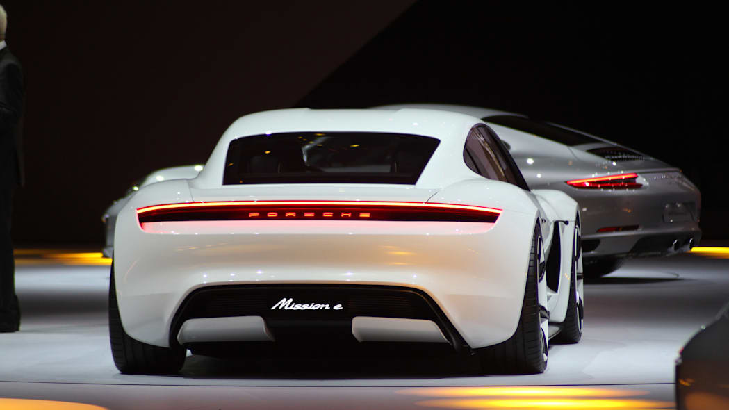 The electric Porsche Mission E concept, showed off at the Volkswagen Group Night ahead of the 2015 Frankfurt Motor Show, long view of the rear.