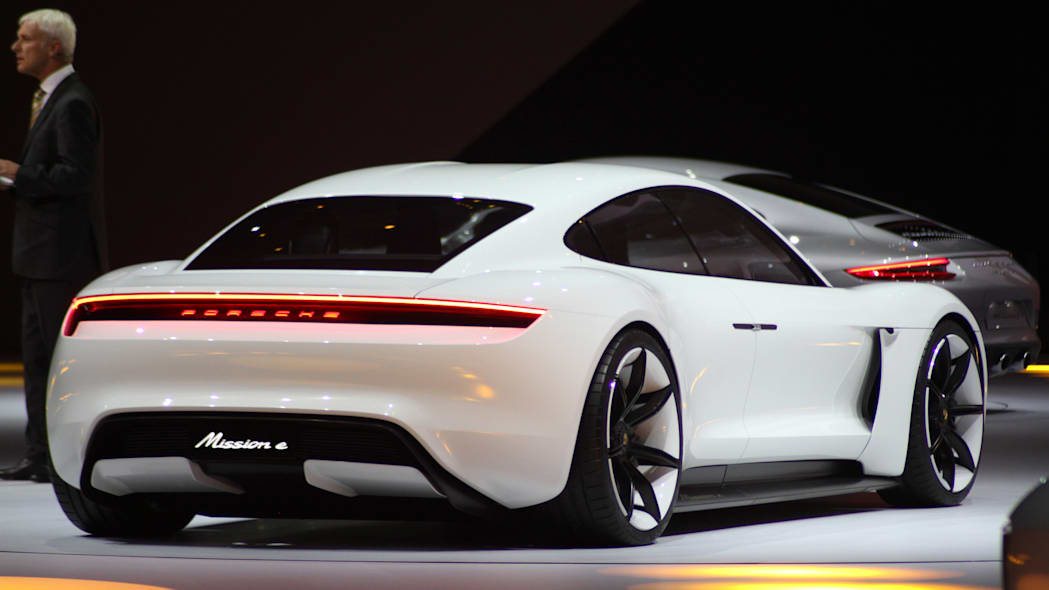 The electric Porsche Mission E concept, showed off at the Volkswagen Group Night ahead of the 2015 Frankfurt Motor Show, rear three-quarter, passenger's side.