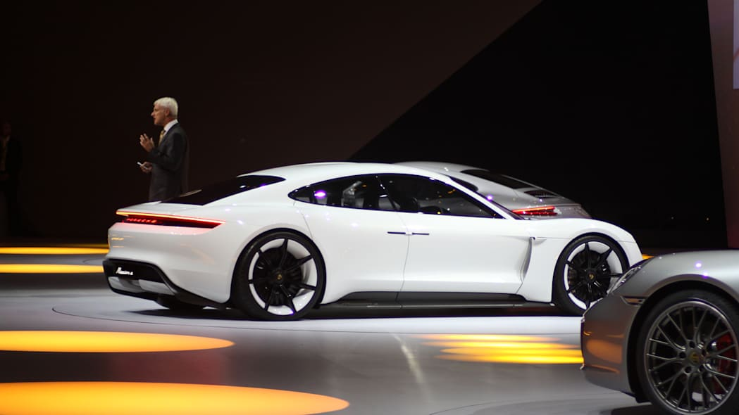 The electric Porsche Mission E concept, showed off at the Volkswagen Group Night ahead of the 2015 Frankfurt Motor Show, rear three-quarter view, passenger's side.
