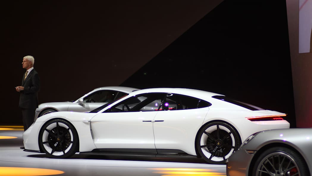 The electric Porsche Mission E concept, showed off at the Volkswagen Group Night ahead of the 2015 Frankfurt Motor Show, long view of the driver's side.
