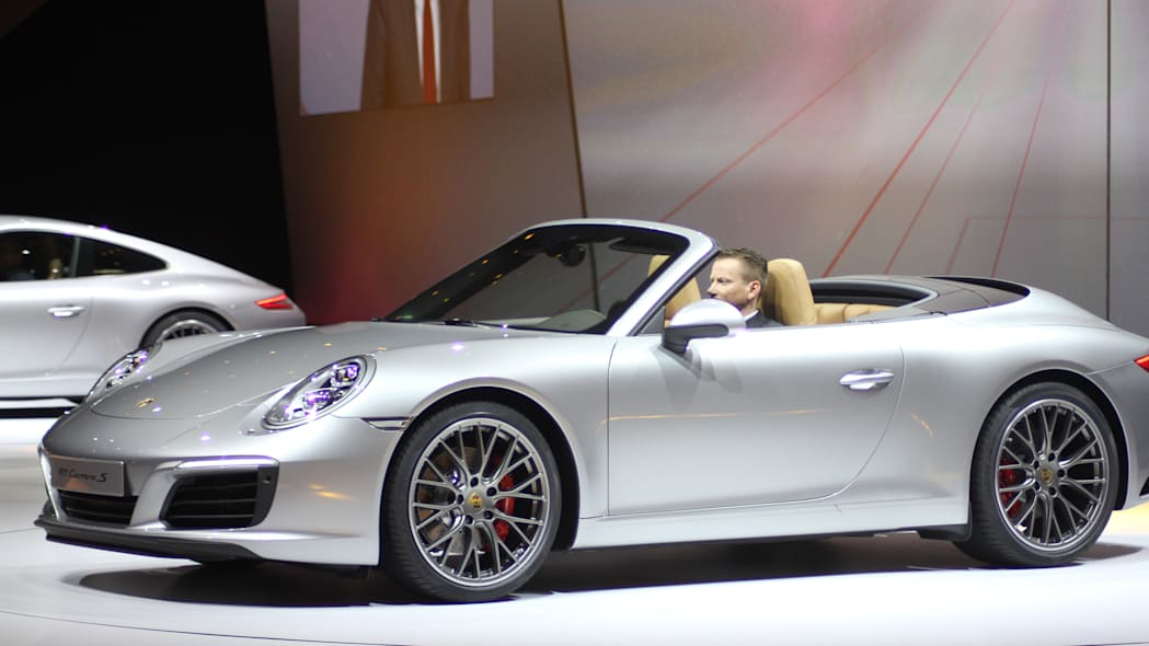 The 2016 Porsche 911 Carrera S Cabriolet, now with a turbocharged engine in the standard car, unveiled at Volkswagen's Group Night ahead of the 2015 Frankfurt Motor Show, near front three-quarter view.