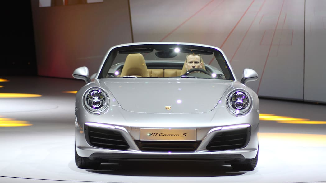 The 2016 Porsche 911 Carrera S Cabriolet, now with a turbocharged engine in the standard car, unveiled at Volkswagen's Group Night ahead of the 2015 Frankfurt Motor Show, front view.