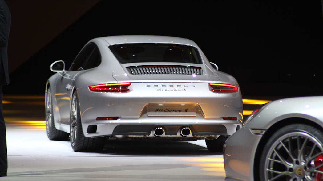 The 2016 Porsche 911 Carrera S, now with a turbocharged engine in the standard car, unveiled at Volkswagen's Group Night ahead of the 2015 Frankfurt Motor Show, rear.