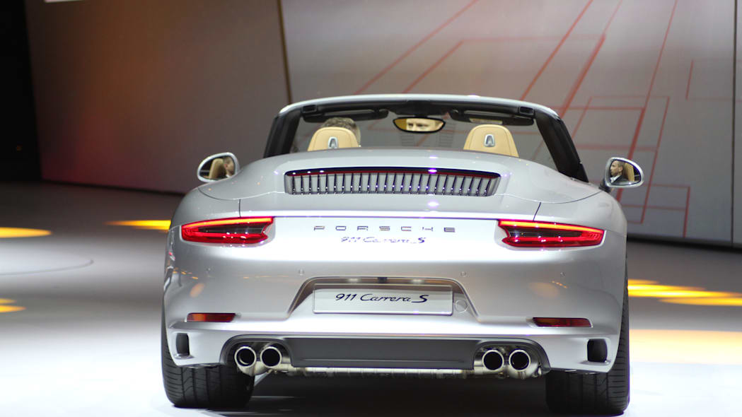 The 2016 Porsche 911 Carrera S Cabriolet, now with a turbocharged engine in the standard car, unveiled at Volkswagen's Group Night ahead of the 2015 Frankfurt Motor Show, rear view.