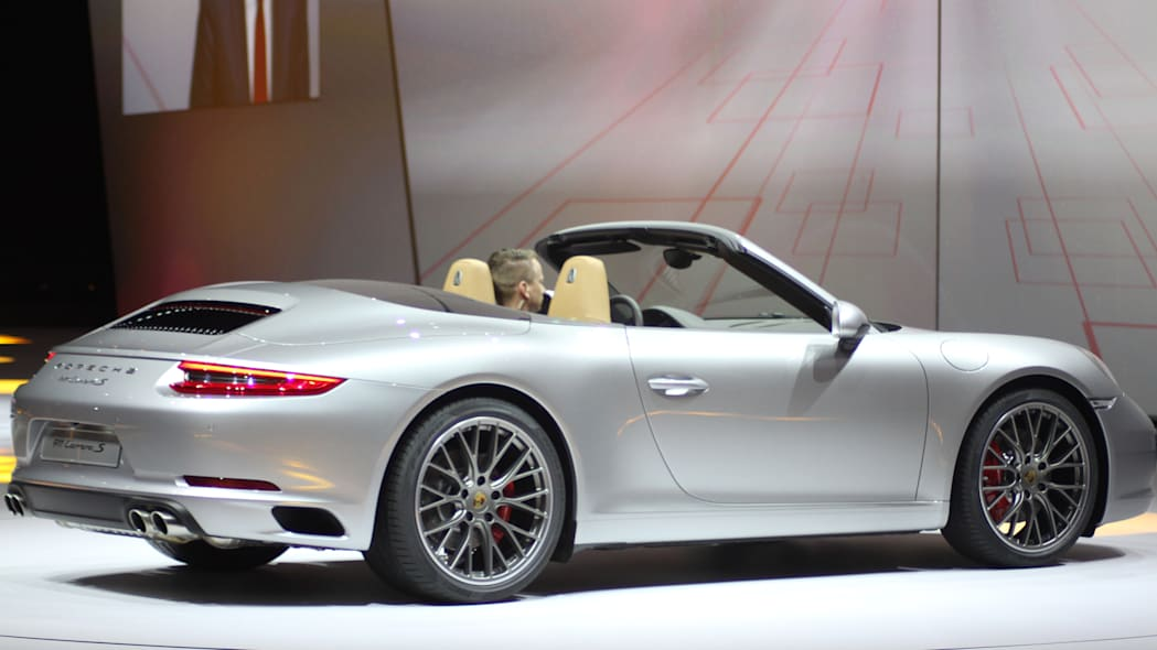 The 2016 Porsche 911 Carrera S Cabriolet, now with a turbocharged engine in the standard car, unveiled at Volkswagen's Group Night ahead of the 2015 Frankfurt Motor Show, rear three-quarter view.