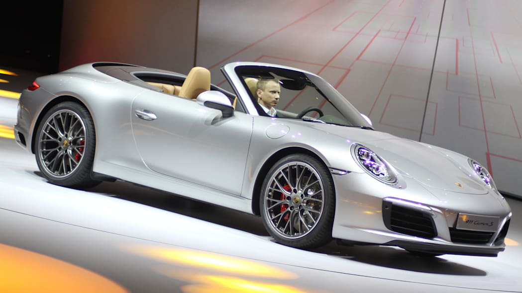 The 2016 Porsche 911 Carrera S Cabriolet, now with a turbocharged engine in the standard car, unveiled at Volkswagen's Group Night ahead of the 2015 Frankfurt Motor Show, front three-quarter view.