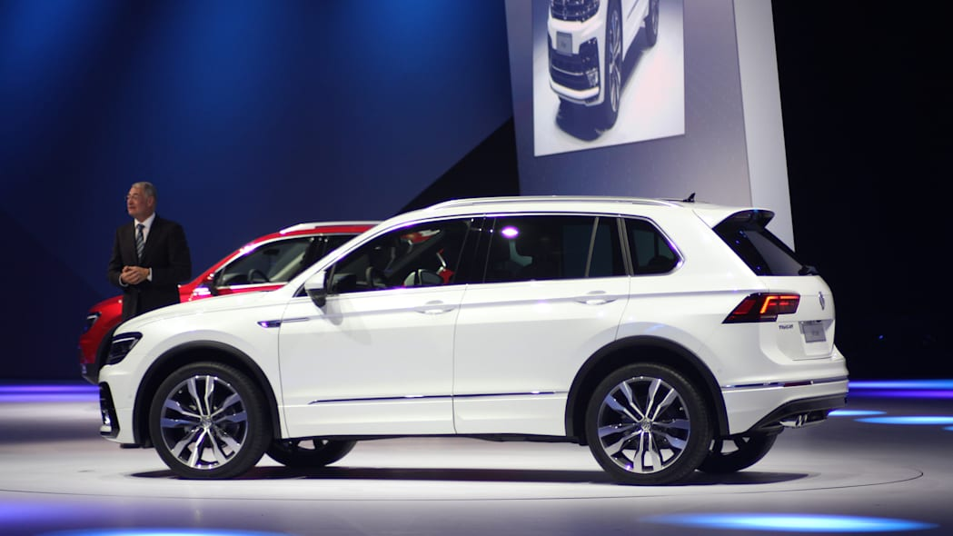 The 2016 Volkswagen Tiguan R-Line, unveiled at Volkswagen's Group Night ahead of the 2015 Frankfurt Motor Show, near rear three-quarter view.