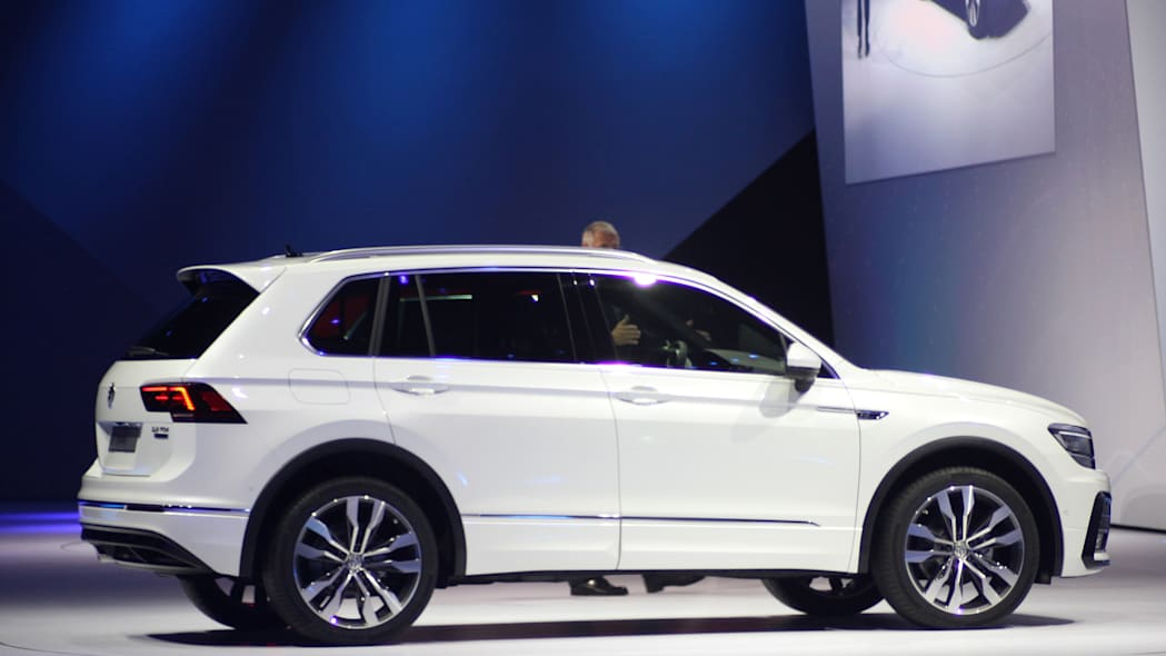 The 2016 Volkswagen Tiguan R-Line, unveiled at Volkswagen's Group Night ahead of the 2015 Frankfurt Motor Show, side view.