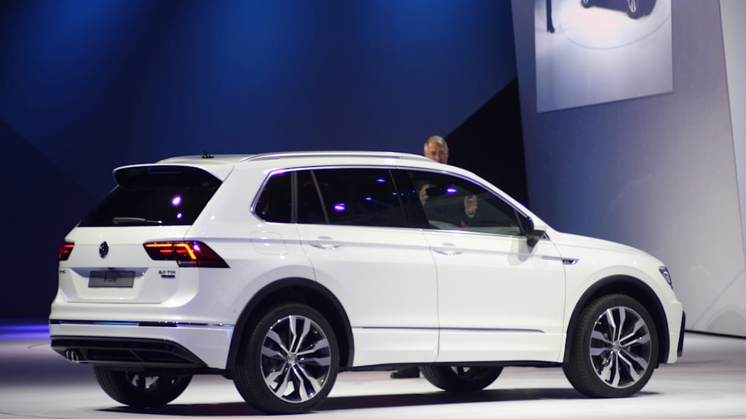 The 2016 Volkswagen Tiguan R-Line, unveiled at Volkswagen's Group Night ahead of the 2015 Frankfurt Motor Show, rear three-quarter.