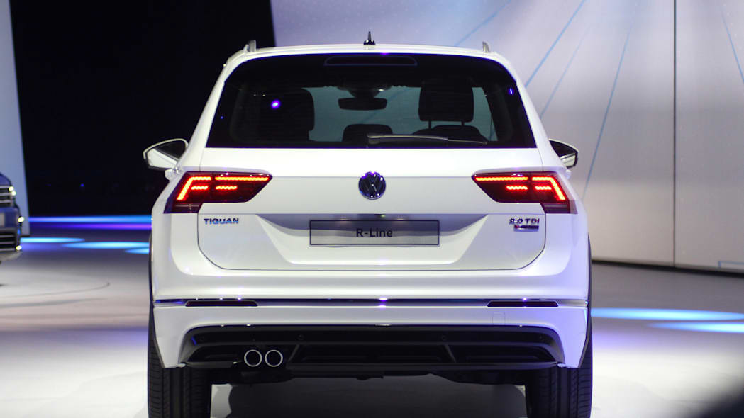The 2016 Volkswagen Tiguan R-Line, unveiled at Volkswagen's Group Night ahead of the 2015 Frankfurt Motor Show, rear view with taillights on.
