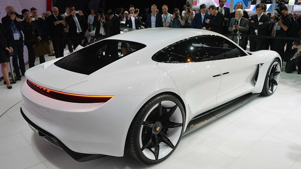 The Porsche Mission E concept, showed off at the 2015 Frankfurt Motor Show, rear three-quarter view.