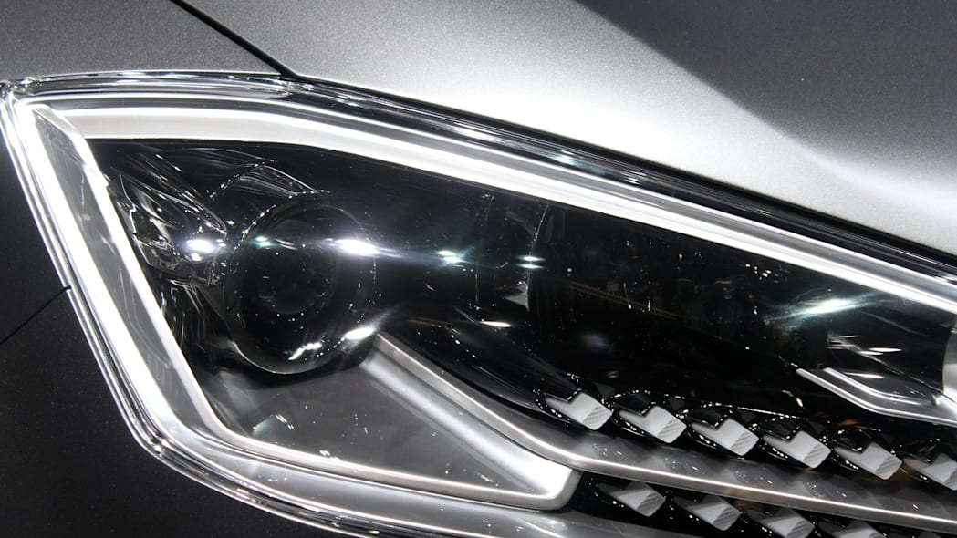 The Borgward BX7 TS, resurrecting the Borgward brand name after 50 years, unveiled at the 2015 Frankfurt Motor Show, headlight detail.