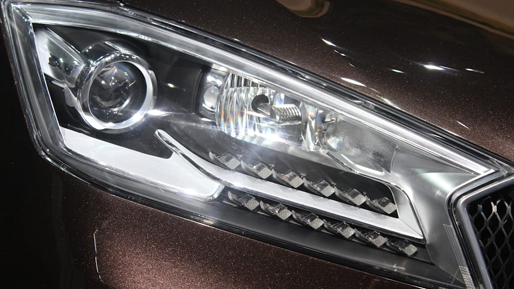 The Borgward BX7, resurrecting the Borgward brand name after 50 years, unveiled at the 2015 Frankfurt Motor Show, headlight detail.