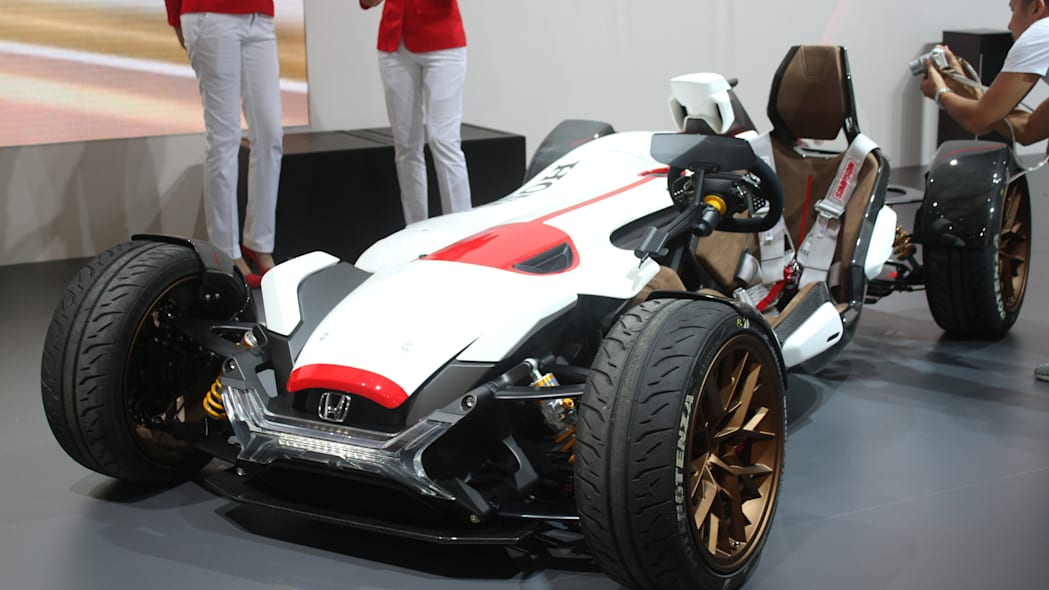 Honda Project 2 & 4 concept that combines the company's RC-213vs MotoGP bike with a car, at the 2015 Frankfurt Motor Show, front three-quarter view.