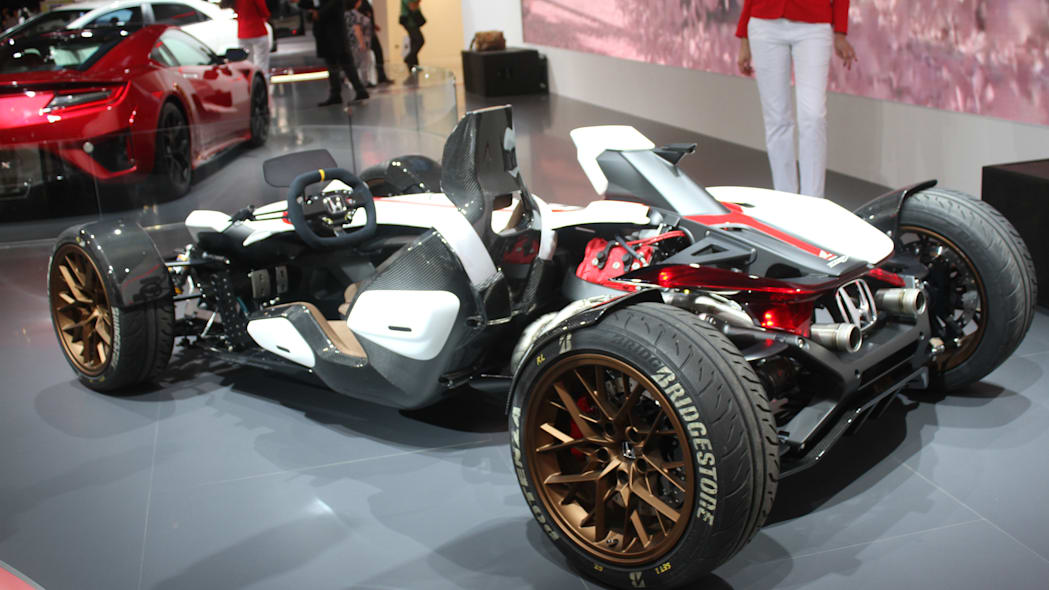 Honda Project 2 & 4 concept that combines the company's RC-213vs MotoGP bike with a car, at the 2015 Frankfurt Motor Show, rear three-quarter view.