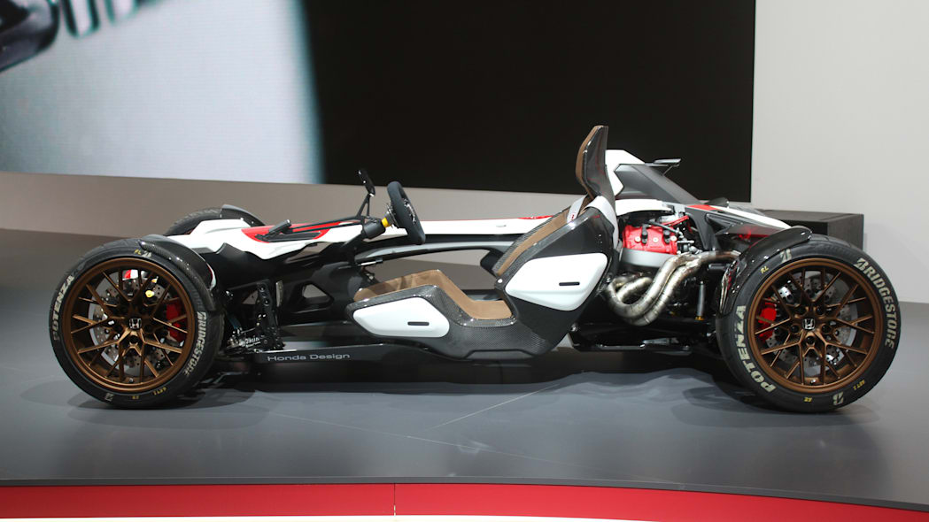 Honda Project 2 & 4 concept that combines the company's RC-213vs MotoGP bike with a car, at the 2015 Frankfurt Motor Show, side view.