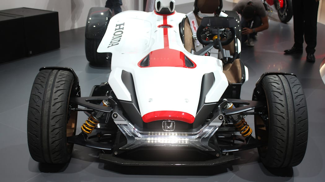 Honda Project 2 & 4 concept that combines the company's RC-213vs MotoGP bike with a car, at the 2015 Frankfurt Motor Show, front view.