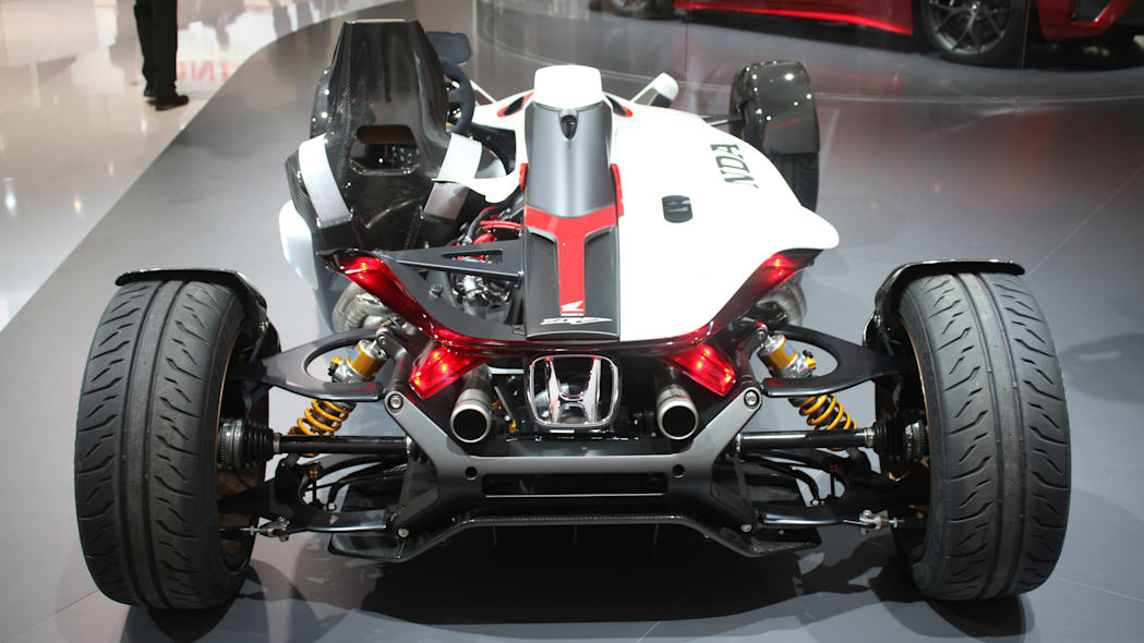 Honda Project 2 & 4 concept that combines the company's RC-213vs MotoGP bike with a car, at the 2015 Frankfurt Motor Show, rear view.
