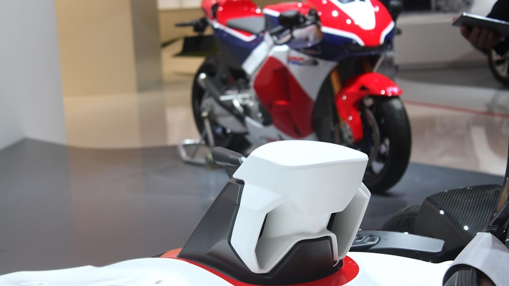 Honda Project 2 & 4 concept that combines the company's RC-213vs MotoGP bike with a car, at the 2015 Frankfurt Motor Show, air intake, with RC213-VS bike in the background.