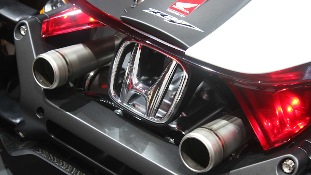 Honda Project 2 & 4 concept that combines the company's RC-213vs MotoGP bike with a car, at the 2015 Frankfurt Motor Show, exhaust detail.