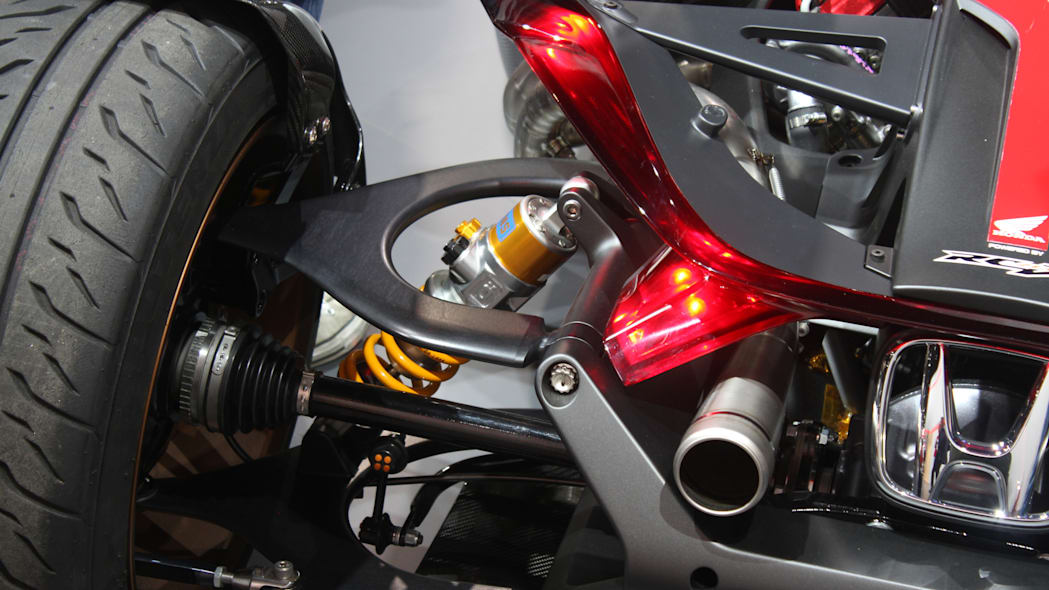 Honda Project 2 & 4 concept that combines the company's RC-213vs MotoGP bike with a car, at the 2015 Frankfurt Motor Show, rear suspension detail.