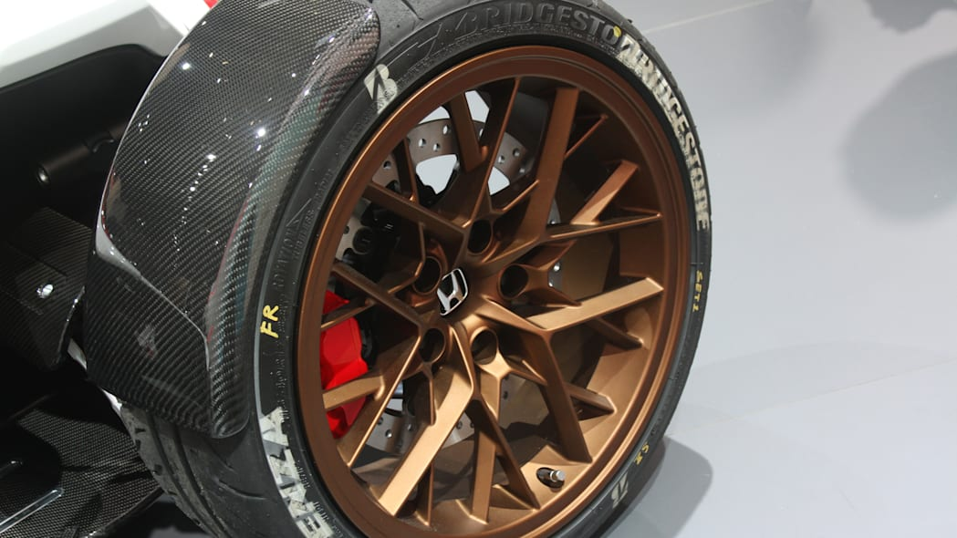 Honda Project 2 & 4 concept that combines the company's RC-213vs MotoGP bike with a car, at the 2015 Frankfurt Motor Show, wheel detail.