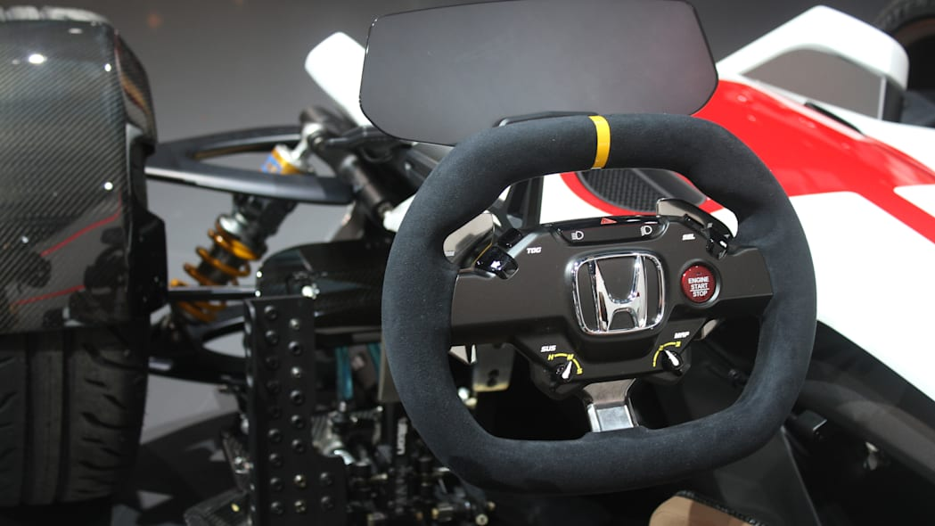 Honda Project 2 & 4 concept that combines the company's RC-213vs MotoGP bike with a car, at the 2015 Frankfurt Motor Show, steering wheel and instrument panel.