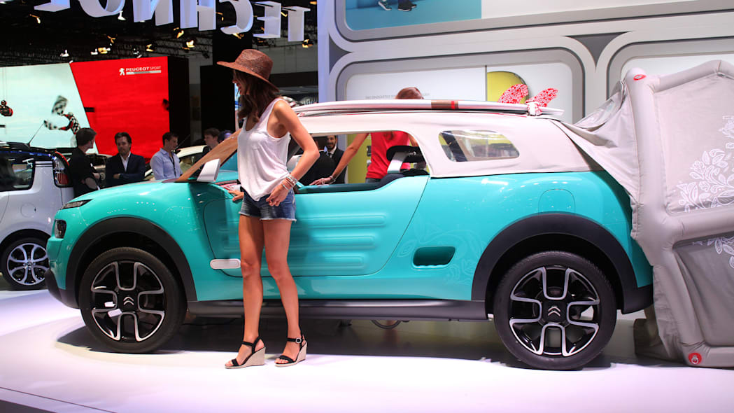 The Citroen Cactus M Concept at the 2015 Frankfurt Motor Show, side view, with model.