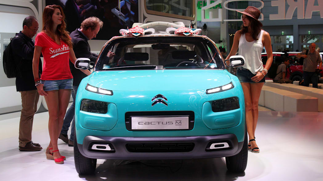 The Citroen Cactus M Concept at the 2015 Frankfurt Motor Show, front view with models.
